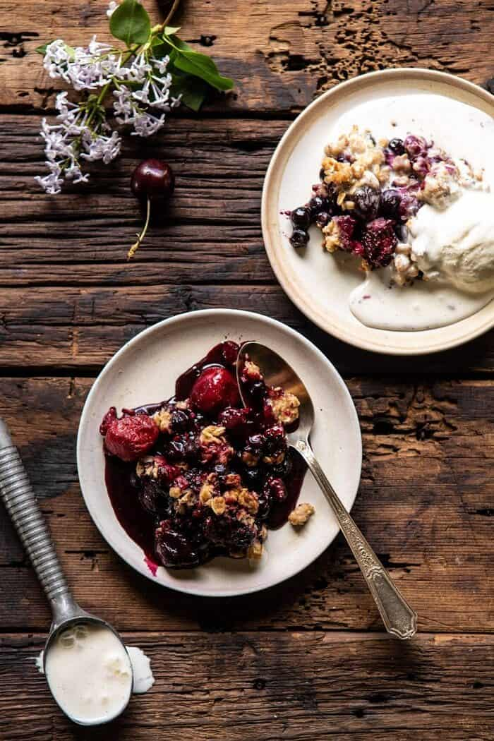 Buttery Cherry Berry Skillet Crisp on 2 serving plates with ice cream