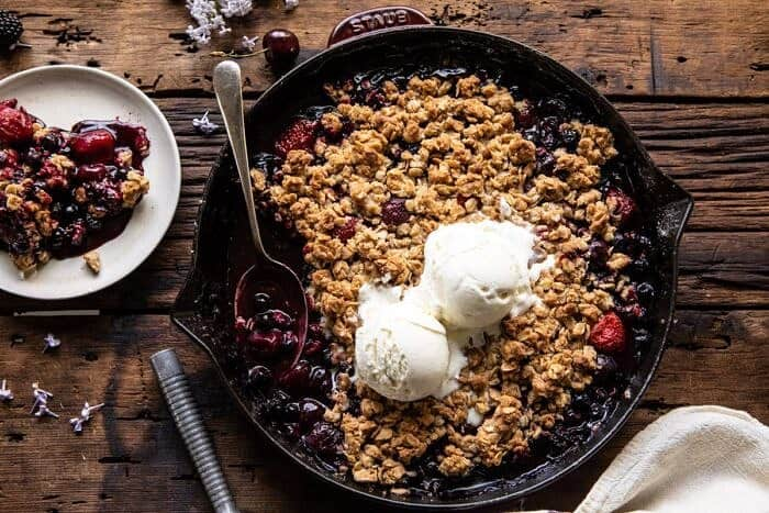 horizontal photo of Buttery Cherry Berry Skillet Crisp