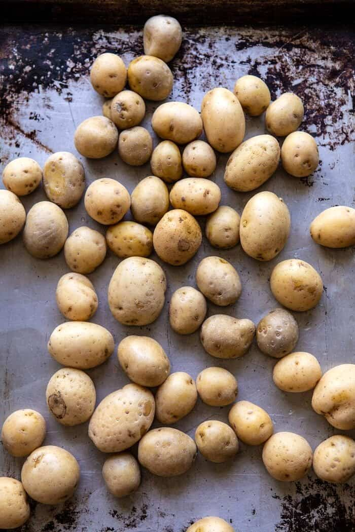 potatoes on baking sheet after cooking in the instant pot