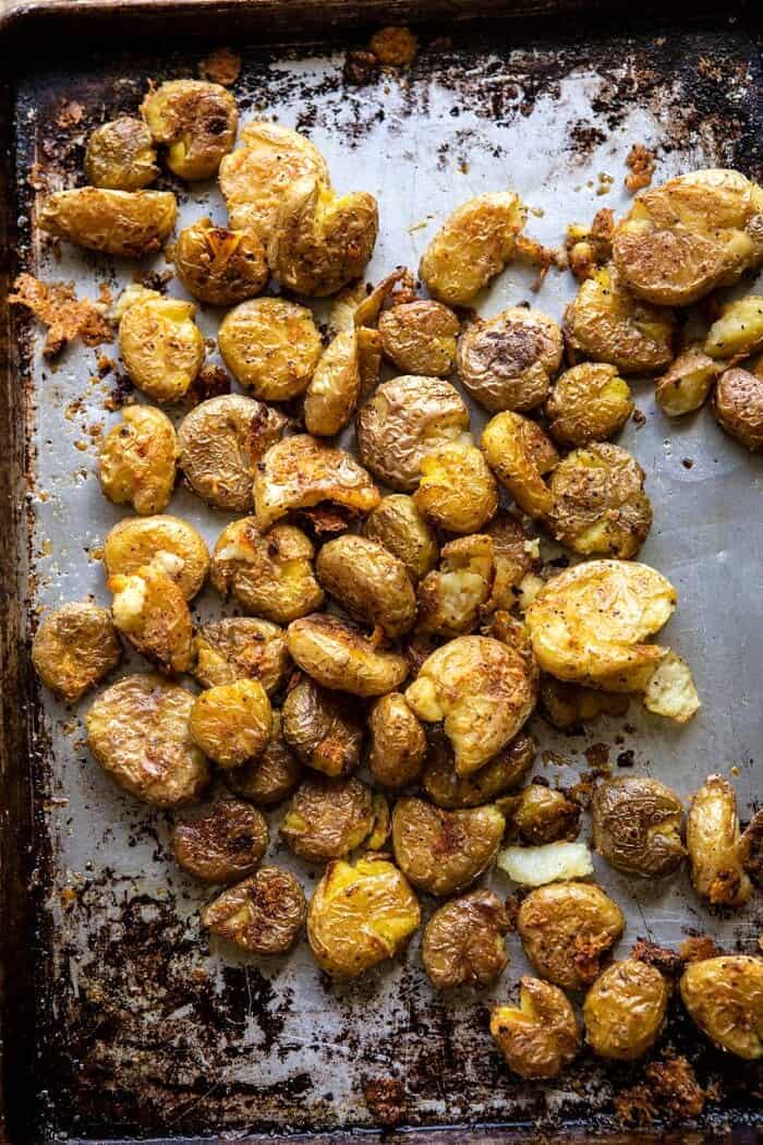 overhead photo of Crispy Salt and Vinegar Smashed Potatoes on baking sheet after roasting