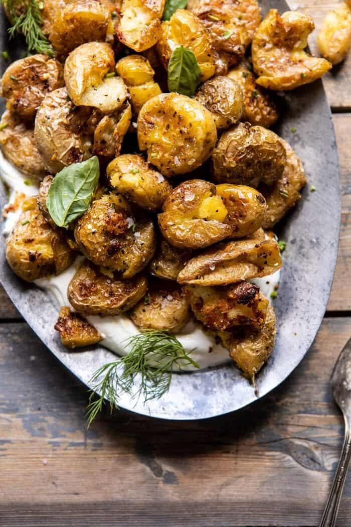 overhead close up photo of Crispy Salt and Vinegar Smashed Potatoes on platter