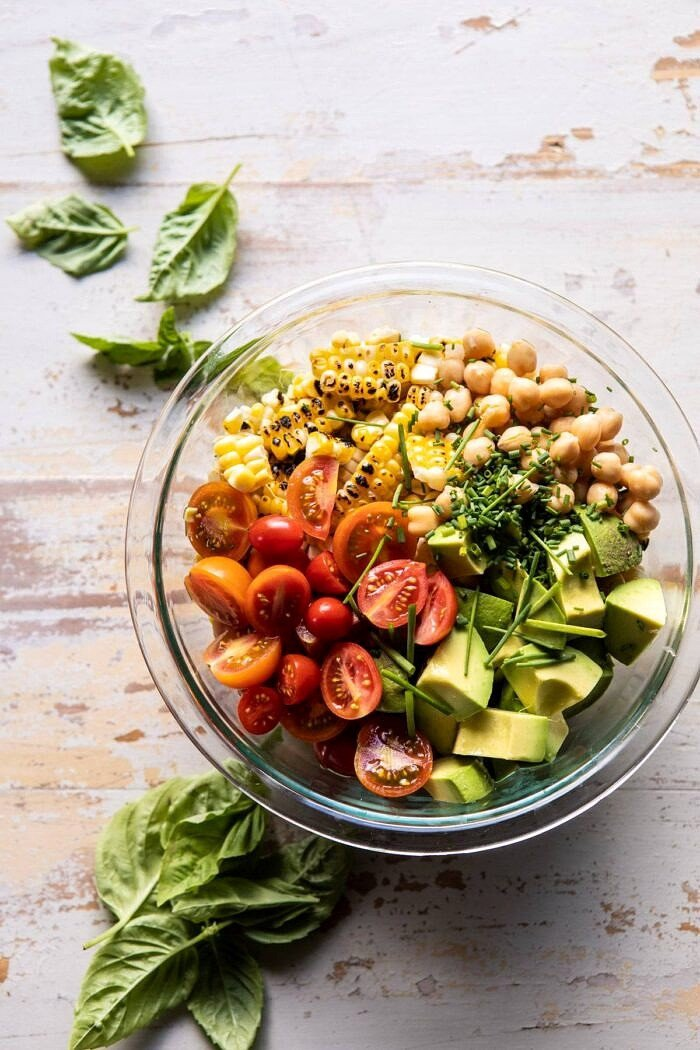 overhead photo of Corn, Tomato, and Avocado Salad in bowl