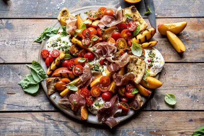 horizontal photo of Peach Caprese Salad with Toasted Garlic Naan