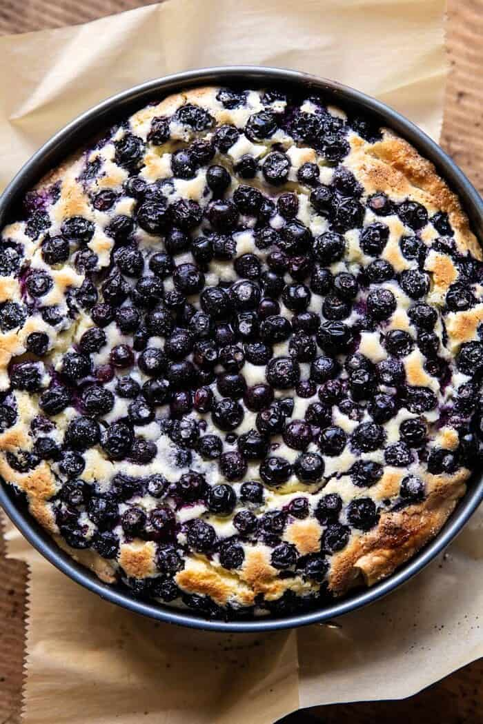 overhead photo of Simple Blueberry Basque Cheesecake in spring form pan after baking