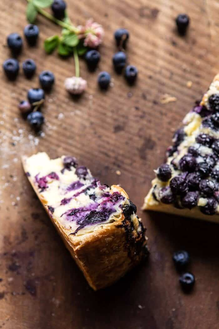 close up photo of Simple Blueberry Basque Cheesecake slice to show the puff pastry crust