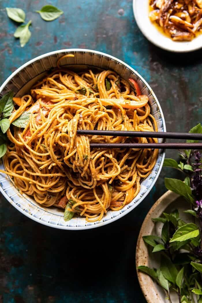 overhead photo of Spicy Peanut Noodles with Chili Garlic Oil and chopsticks in bowl