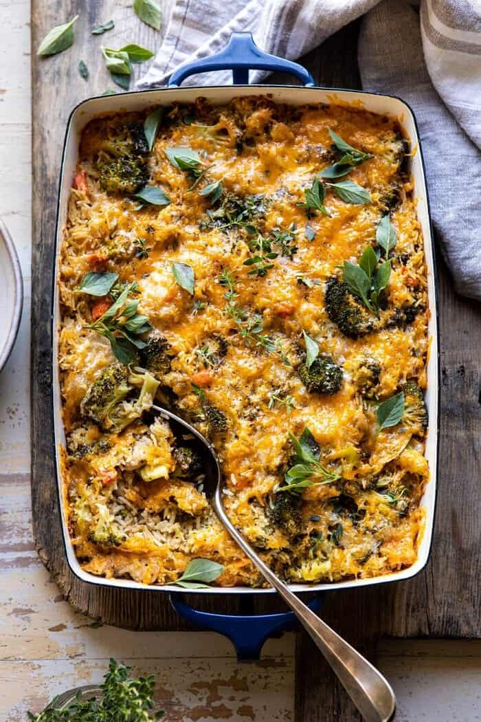 overhead photo of Broccoli Cheddar Chicken and Rice Casserole with spoon in casserole dish
