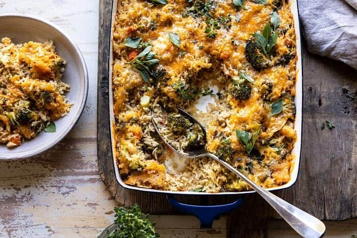 overhead horizontal photo of Broccoli Cheddar Chicken and Rice Casserole with spoon in casserole dish