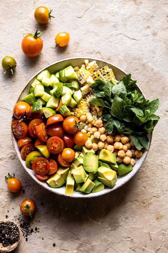 overhead photo of Corn, Tomato, and Avocado Chickpea Salad before tossing