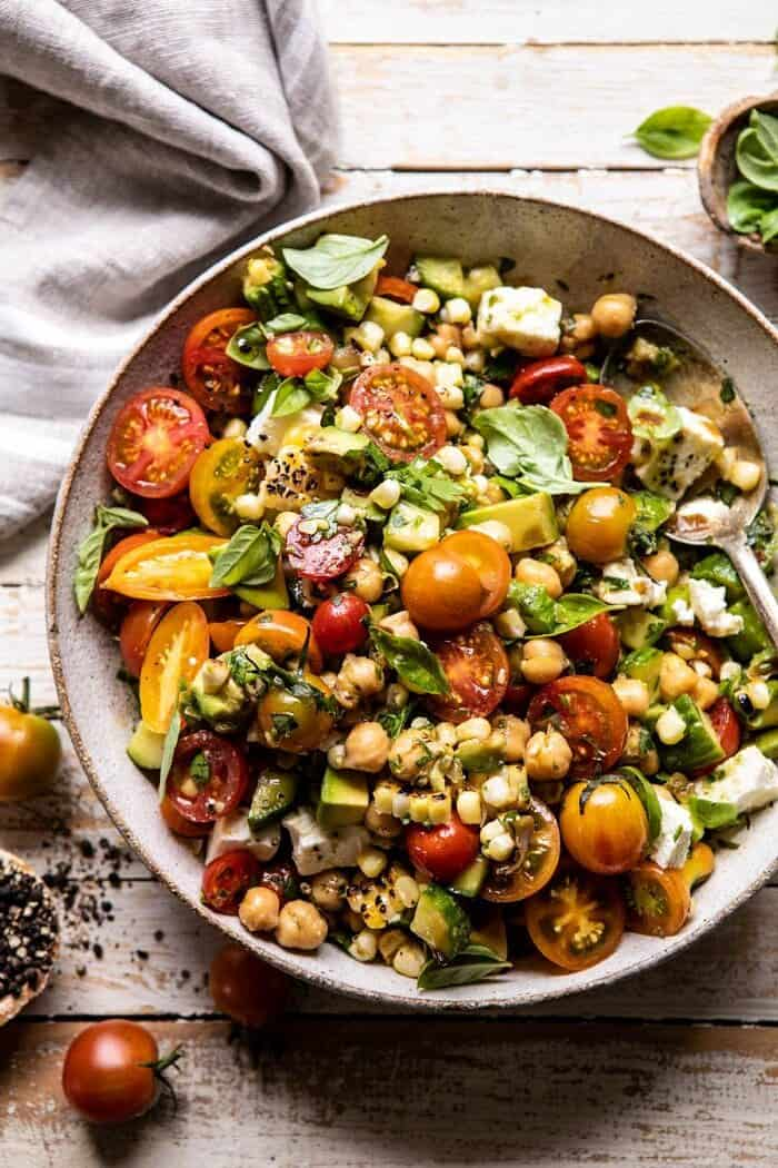overhead close up photo of Corn, Tomato, and Avocado Chickpea Salad after tossing