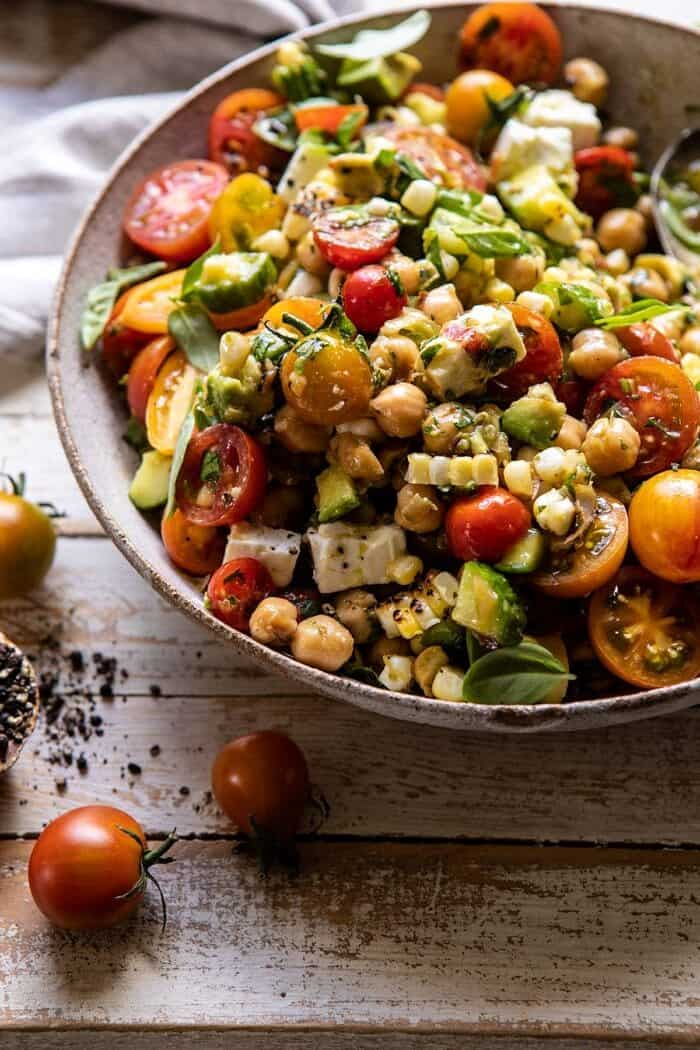 side angled photo of Corn, Tomato, and Avocado Chickpea Salad after tossing