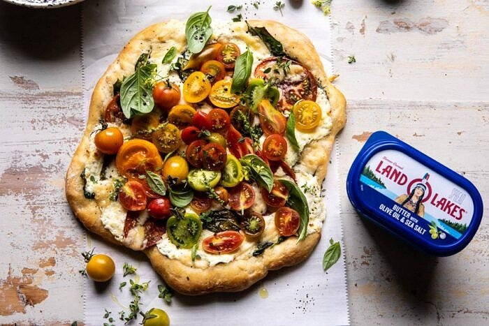horizontal photo of Herbed Butter Heirloom Tomato Pizza