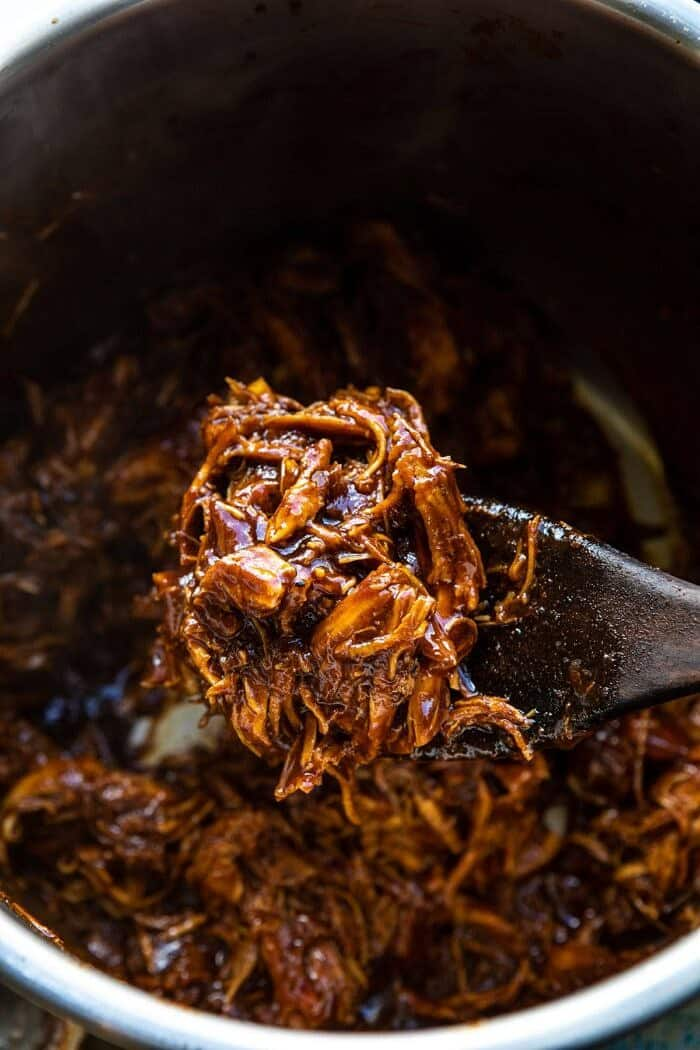 overhead photo of Instant Pot BBQ Beer Pulled Chicken in instant pot bowl