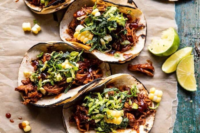 overhead horizontal photo of Instant Pot BBQ Beer Pulled Chicken Tacos with Ranch Corn Slaw