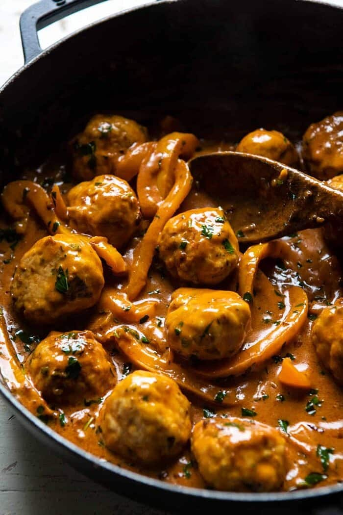 side angled photo of Weeknight 30 Minute Coconut Curry Chicken Meatballs in skillet