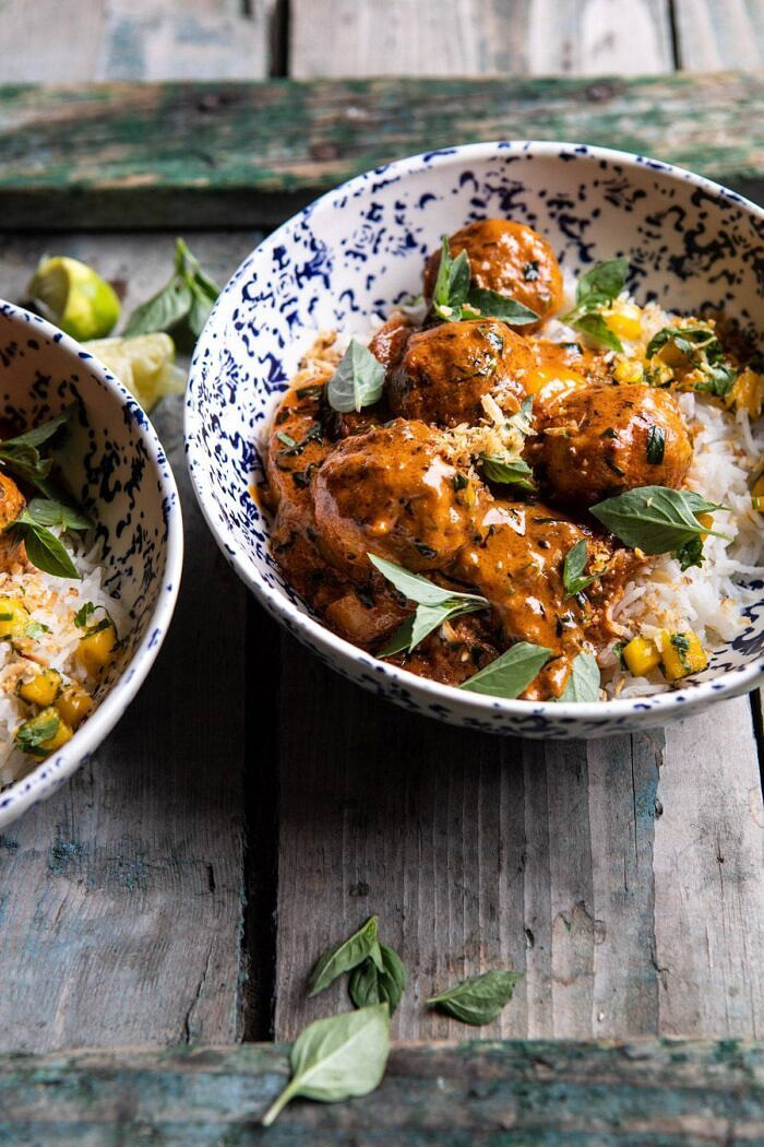 side angled photo of Weeknight 30 Minute Coconut Curry Chicken Meatballs in bowls with rice