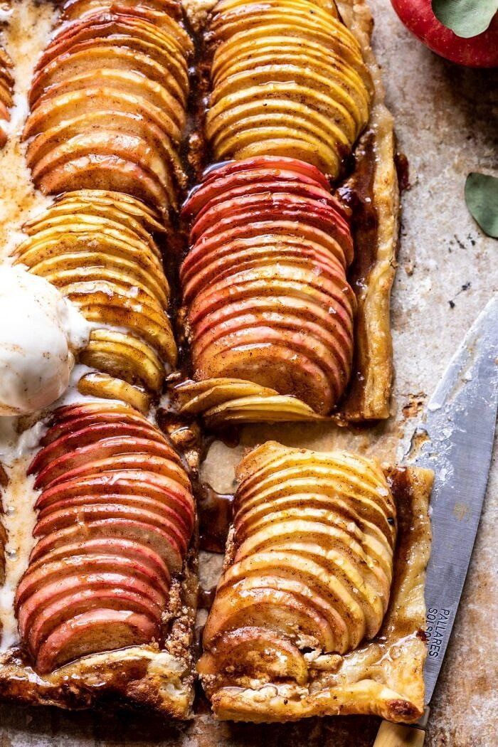 overhead close up photo of Chai Spiced Apple Ricotta Galette with 1 slice cut out