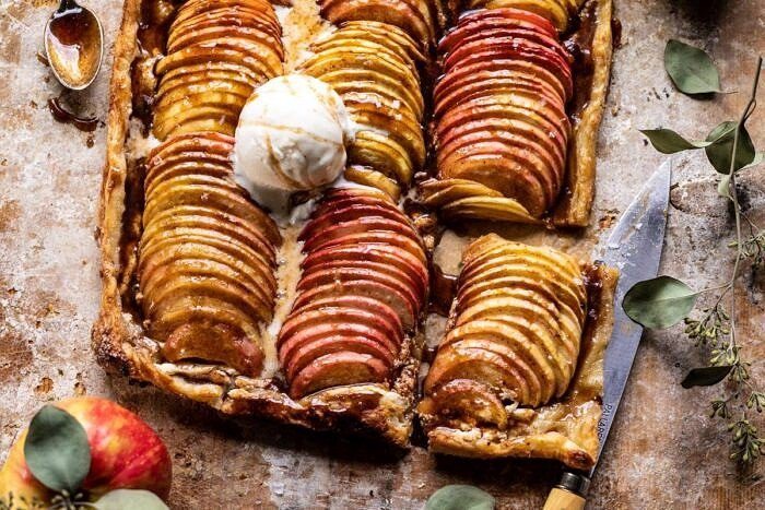 horizontal photo of Chai Spiced Apple Ricotta Galette with one slice cut