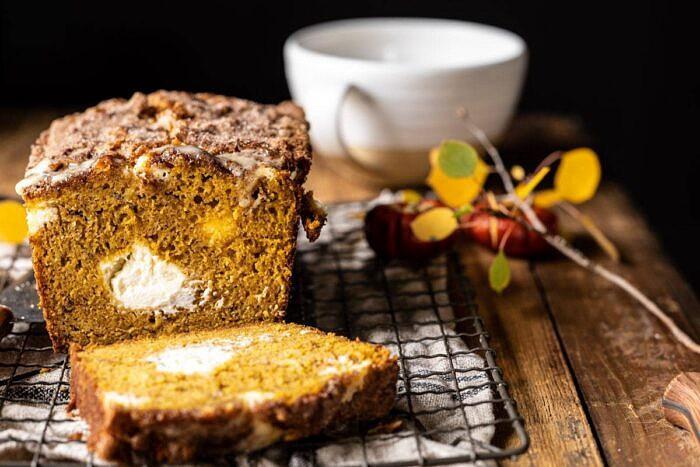 horizontal photo of Cream Cheese Swirled Pumpkin Bread with 1 slice cut