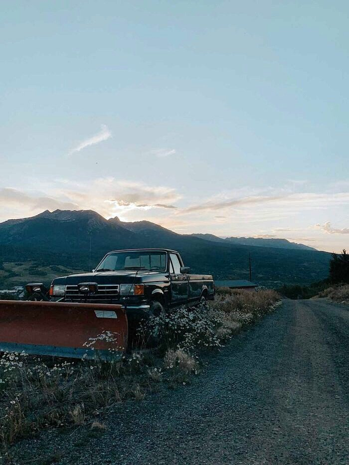 pickup truck with mountains in background