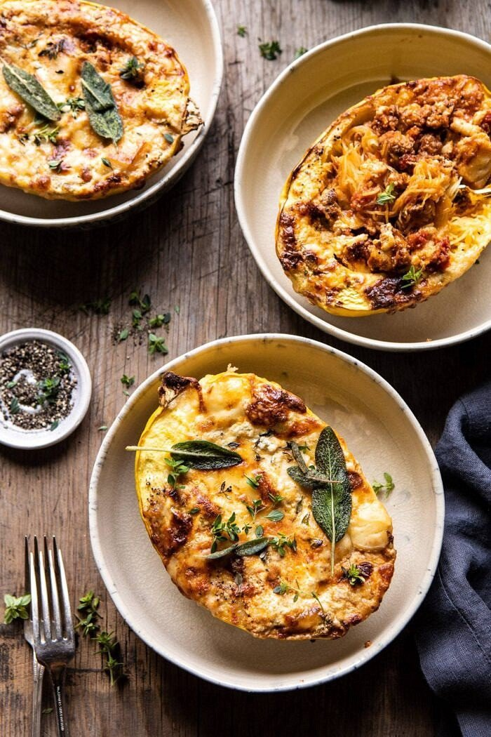 overhead photo of Roasted Garlic Spaghetti Squash Lasagna Boats with 3 bowls of squash in photo