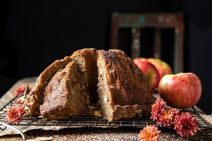 horizontal photo of Spiced Pecan Apple Cider Doughnut Cake with pieces cut
