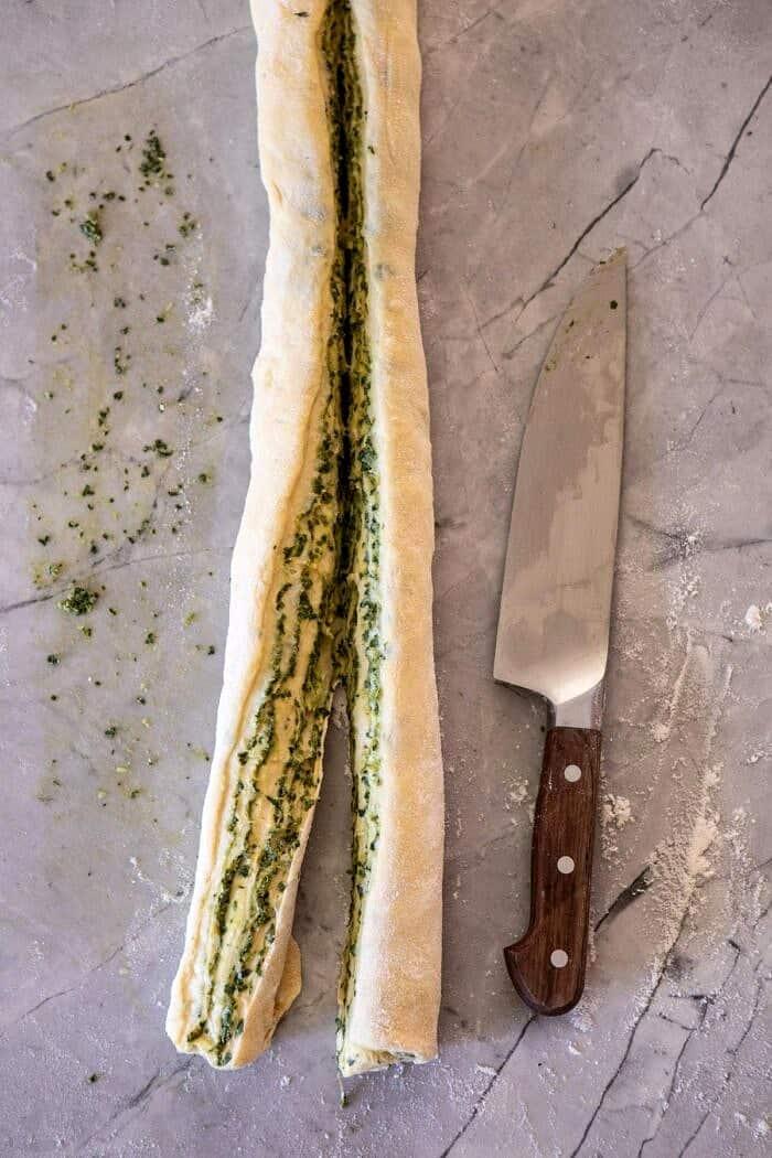 dough log after slicing in half lengthwise