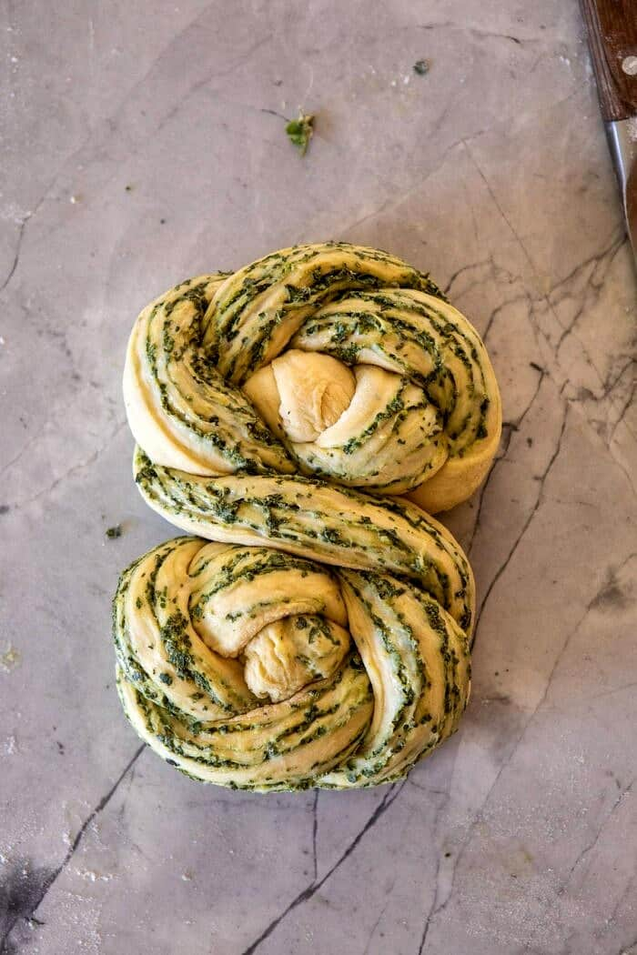 Swirled Garlic Herb Bread on counter before baking