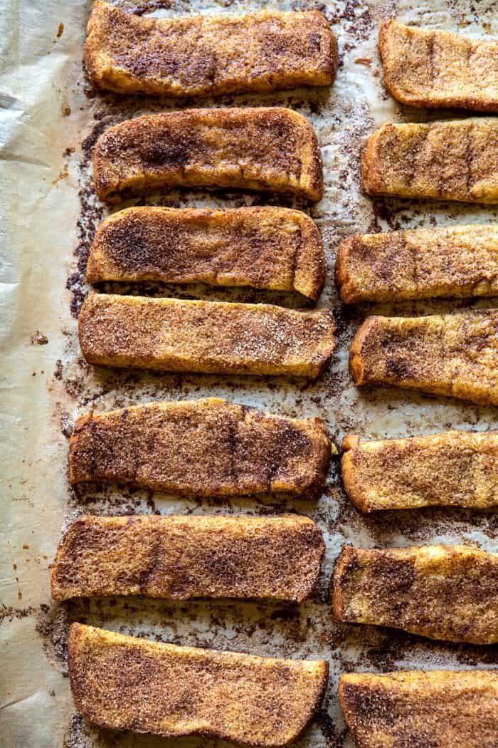 overhead photo of Cinnamon Sugar French Toast Sticks after baking on baking sheet