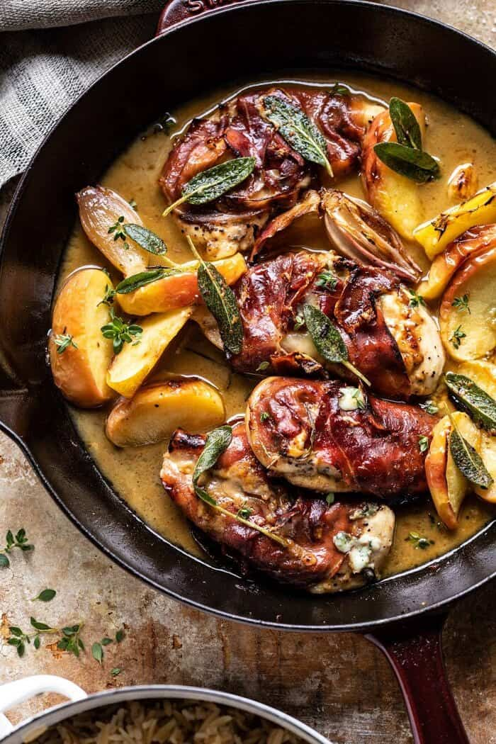 overhead close up photo of Prosciutto Apple and Sage Butter Chicken with Cider Pan Sauce in skillet