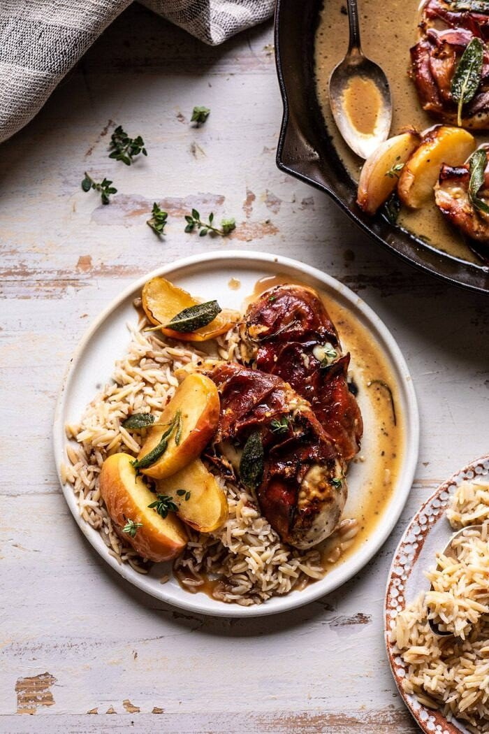 overhead photo of Prosciutto Apple and Sage Butter Chicken with Cider Pan Sauce on a plate with rice pilaf