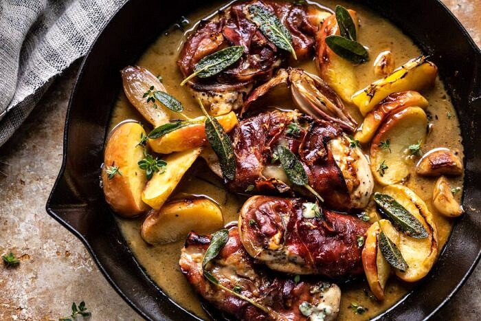 horizontal photo of Prosciutto Apple and Sage Butter Chicken with Cider Pan Sauce in skillet
