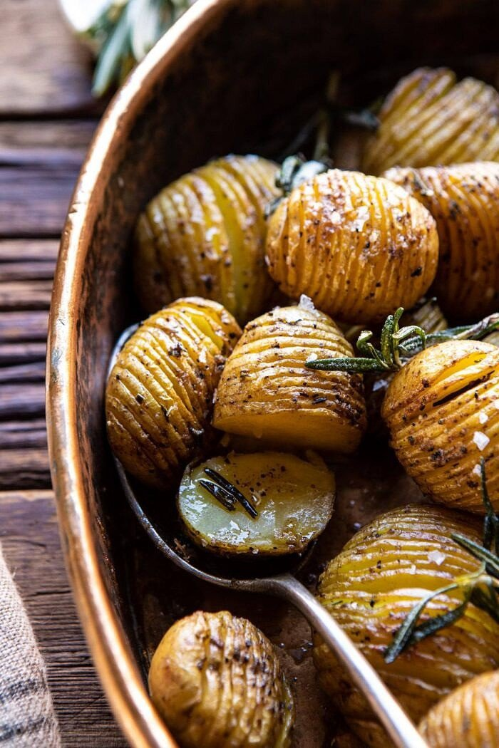 side angled photo of Crispy Rosemary Butter Roasted Potatoes butter on potatoes