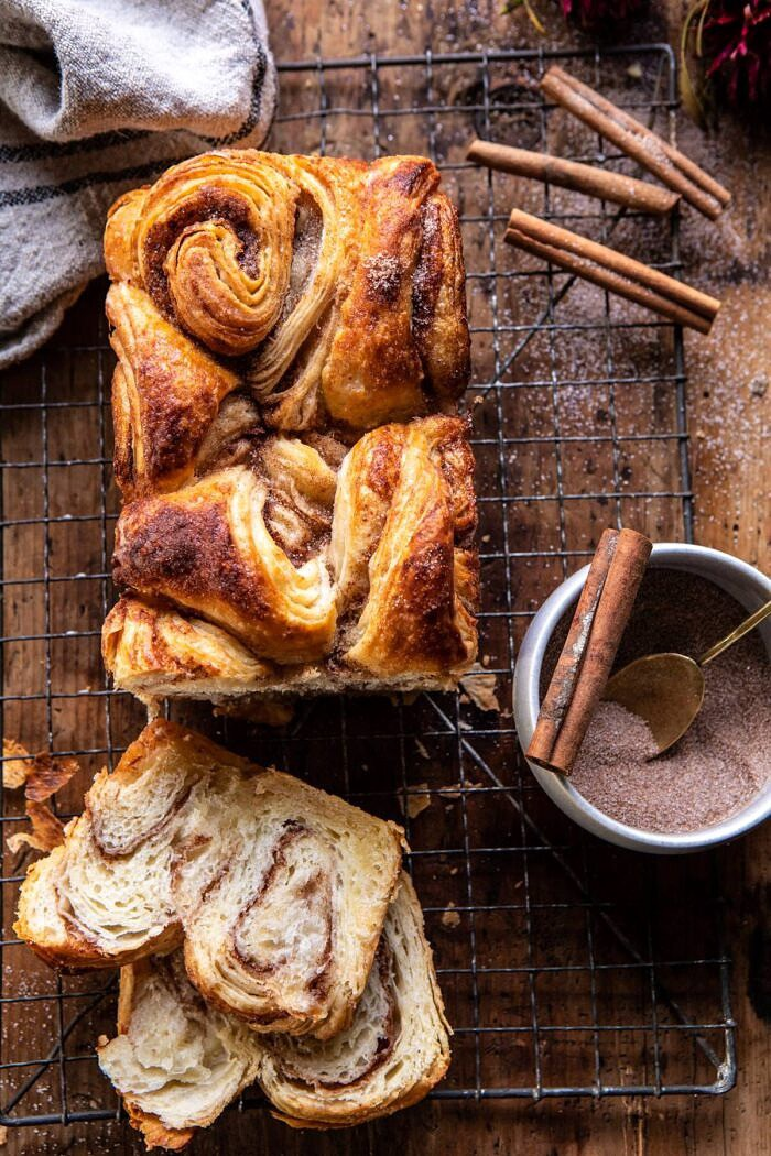 overhead photo of Easy Swirled Cinnamon Sugar Croissant Loaf with 2 slices of bread cut and cinnamon sugar in photo