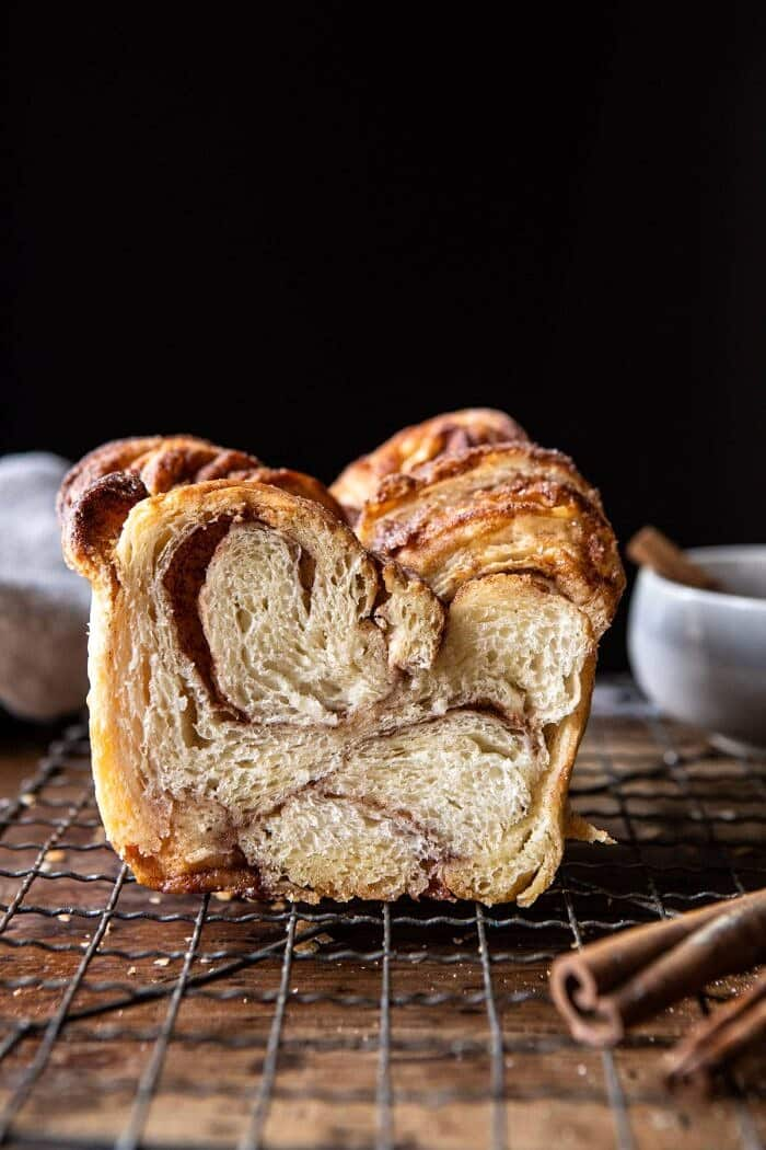 side angled photo of Easy Swirled Cinnamon Sugar Croissant Loaf with loaf cut in half to show the inside