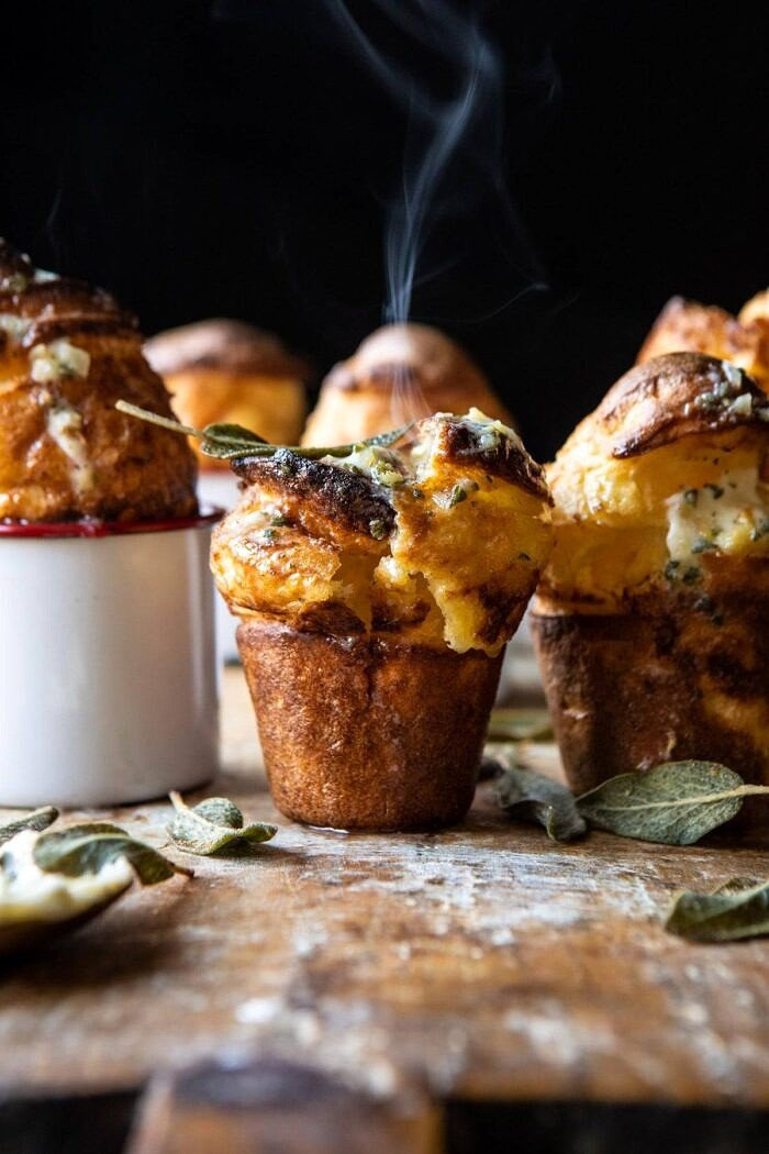 Parmesan Popovers with Crispy Sage Garlic Butter with steam coming out
