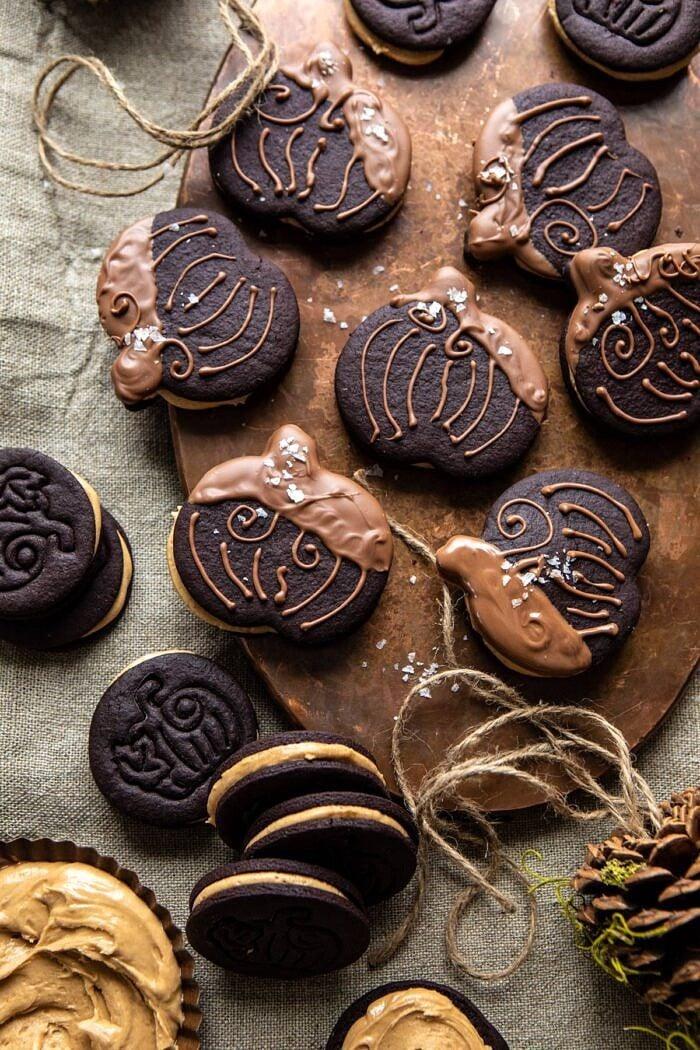 overhead photo of Peanut Butter Stuffed Chocolate Jack-O'-Lantern Cookies on serving trey
