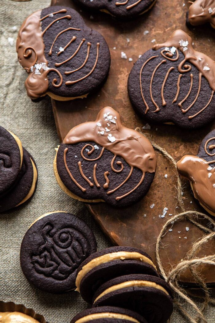 overhead close up photo of Peanut Butter Stuffed Chocolate Jack-O'-Lantern Cookies on serving trey