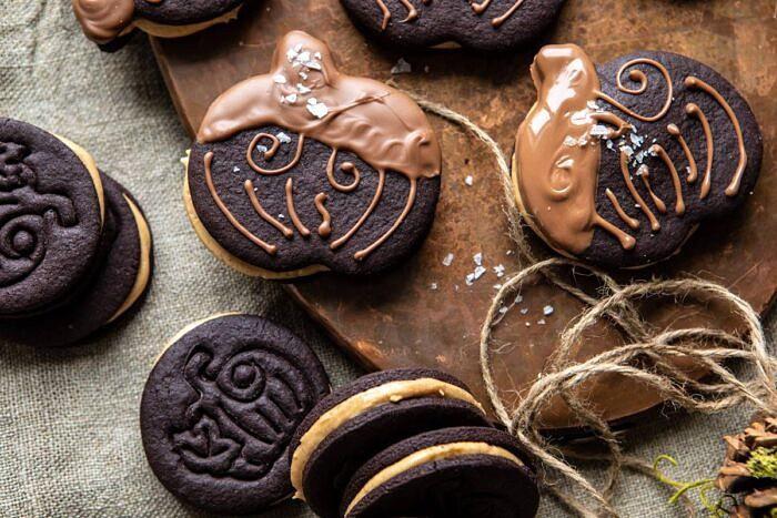 overhead horizontal photo of Peanut Butter Stuffed Chocolate Jack-O'-Lantern Cookies