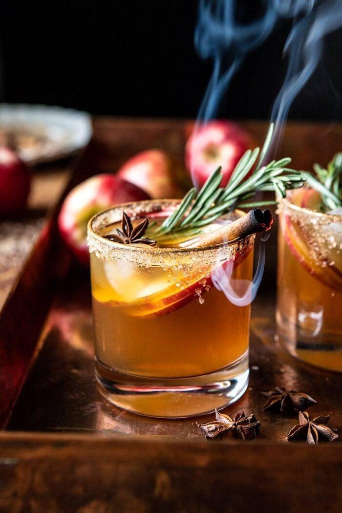 side angled close up photo of Smoky Harvest Apple Cider Margarita with smoking cinnamon stick
