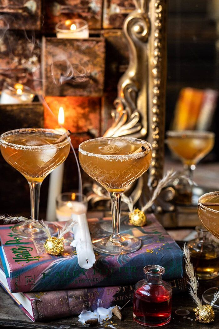 front on photo of The Golden Snitch Cocktail with candle blown out and smoking