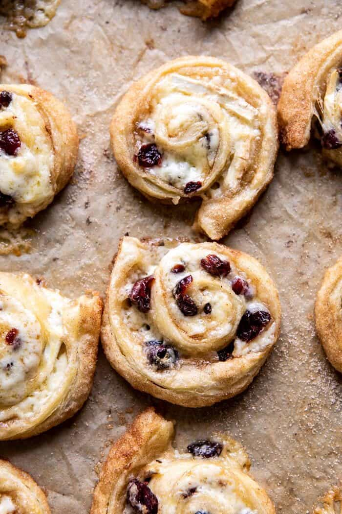 overhead photo of 5 Ingredient Cranberry Brie Cinnamon Puff Pastry Swirls on baking sheet after baking
