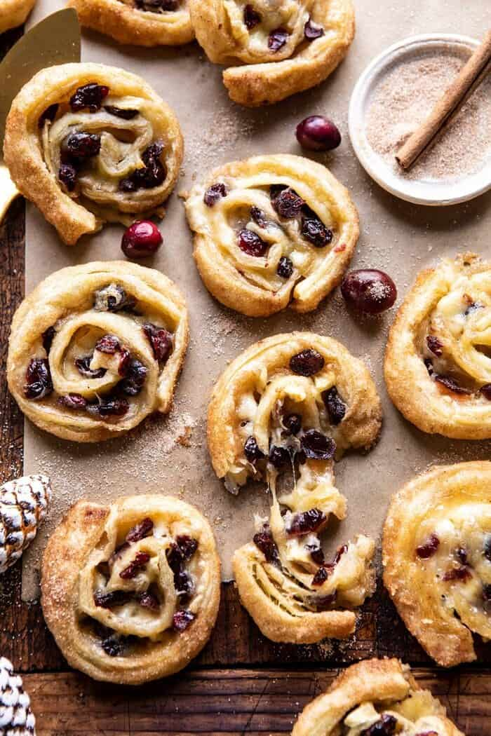 overhead photo of 5 Ingredient Cranberry Brie Cinnamon Puff Pastry Swirls with cheese being pulled out of swirl