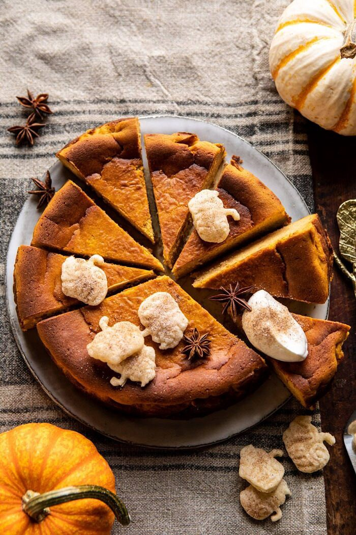 overhead photo of Burnt Basque Pumpkin Spice Cheesecake with multiple sliced of cheesecake cut