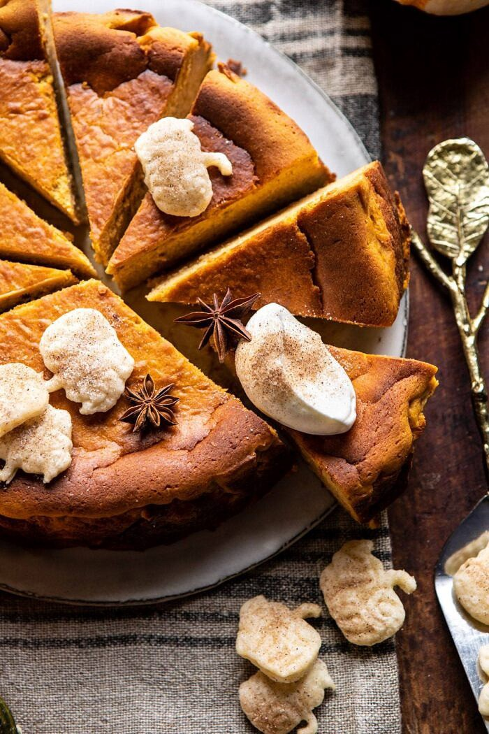 side angled close up photo of Burnt Basque Pumpkin Spice Cheesecake with whipped cream on slice