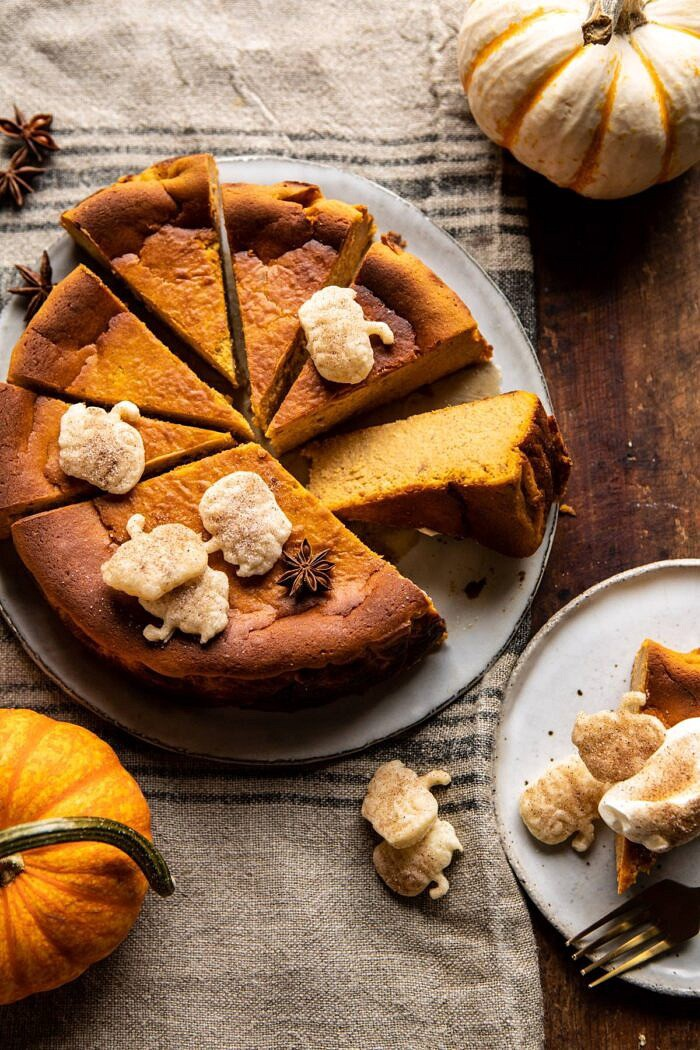 overhead photo of Burnt Basque Pumpkin Spice Cheesecake with multiple slices cut and 1 slice turned outward to show the center of cake