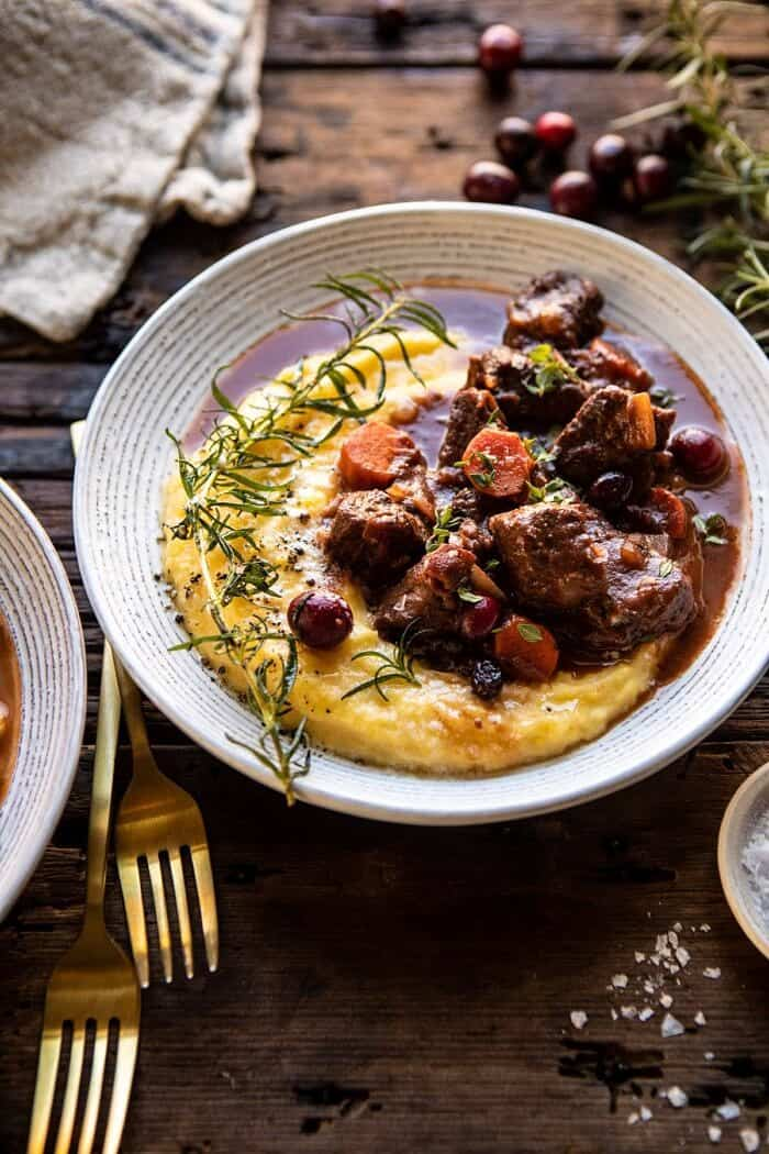 side angled photo of Cranberry Cider Braised Beef Stew with Rosemary Polenta