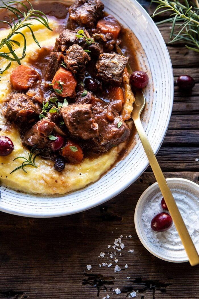 overhead photo of Cranberry Cider Braised Beef Stew with Rosemary Polenta with fork in bowl