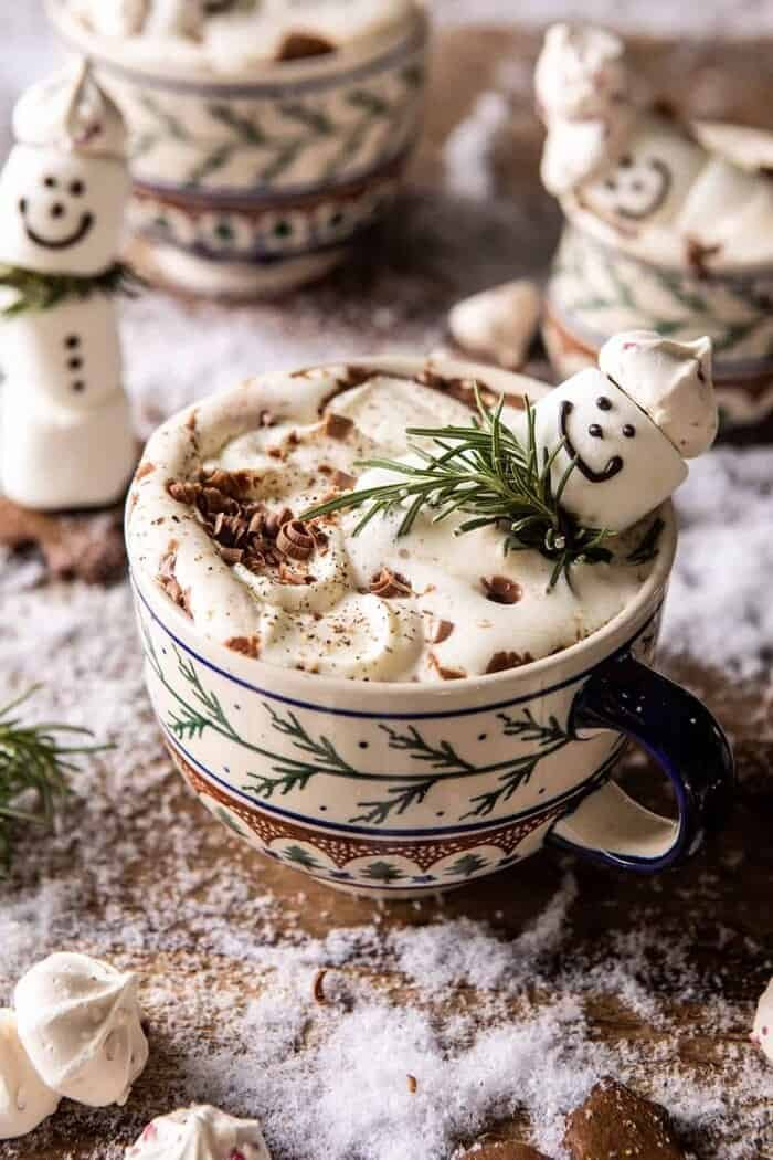 front on photo of Creamy Coconut Hot Chocolate with melting snowman marshmallow in hot cocoa
