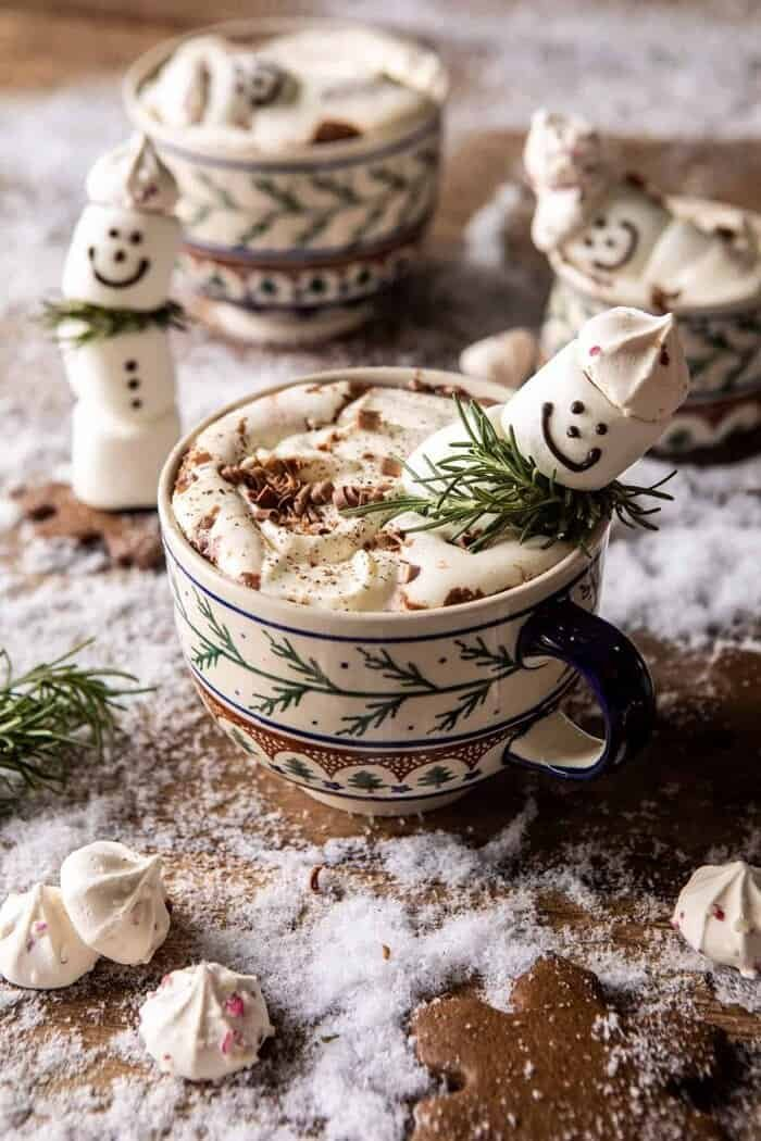 front on photo of Creamy Coconut Hot Chocolate with melting snowman in mug